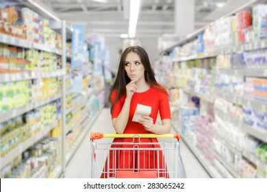 Curious Woman in The Supermarket with Shopping List- Young girl in a market store with a shopping list thinking what to buy