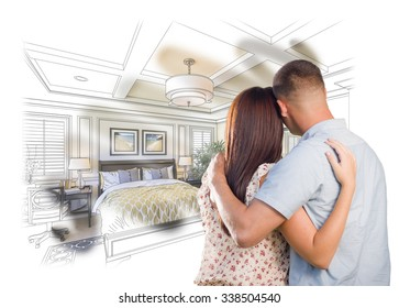 Curious Young Military Couple Looking Over Custom Bedroom Design Drawing Photo Combination. The framed art is photographer's copyright.