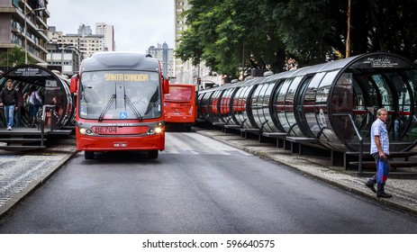 CURITIBA, BRAZIL - MARCH 15: The architecture of the Public Transportation System of Curitiba in Parana, Brazil with its tubular shelters and locals getting in and out buses on March 15, 2014.