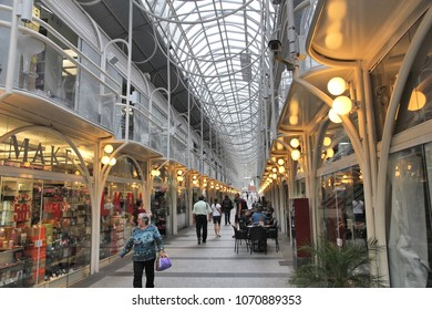 CURITIBA, BRAZIL - OCTOBER 7, 2014: People visit 24 Hours Street in Curitiba. The indoor shopping street is the heart of Curitiba, 8th most populous city of Brazil with 1.76 million inhabitants.