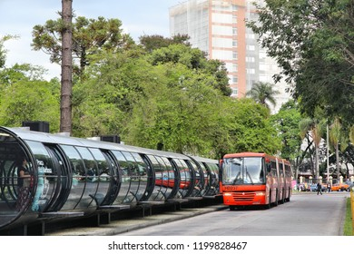 CURITIBA, BRAZIL - OCTOBER 7, 2014: People ride city bus in Curitiba, Brazil. Curitiba's bus system is world famous for its efficiency. Founded in 1974, it serves 2.3 million daily rides.