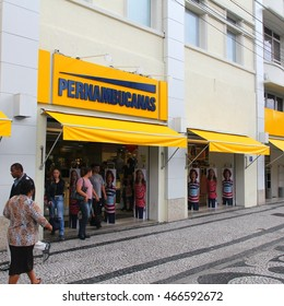 CURITIBA, BRAZIL - OCTOBER 7, 2014: People shop in Pernambucanas in Curitiba, Brazil. Pernambucanas is the 3rd biggest fashion retailer in Brazil with 303 stores and 4.26 billion BRL revenue in 2012.