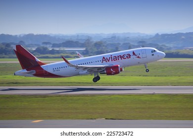CURITIBA, BRAZIL - OCTOBER 9, 2014: Avianca Airlines Airbus A320 takes off from Curitiba Airport, Brazil. Avianca group carried 24.6 million passengers in 2013.