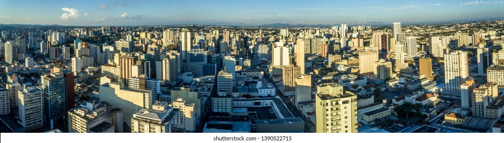 curitiba city in the late afternoon of a beautiful sunday sun, with few clouds in the sky, photographed by drone, forming this beautiful and magnificent view of downtown in brazil.