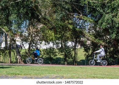 Curitiba, Parana, Brazil, August 25, 2019, People riding a bicycle on a Sunday afternoon