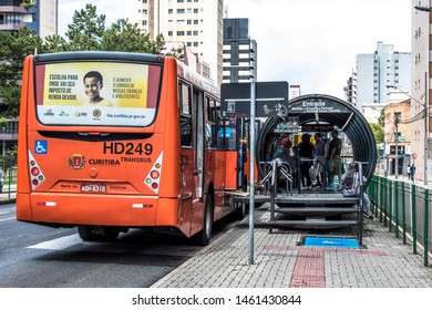 Curitiba, Parana, December 30, 2017. View of the passenger movement in the tube station, tube-shaped bus stop of the Integrated Transport Network, in downrown of Curitiba.