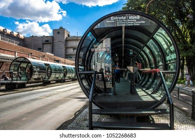 Curitiba, Parana, Januay 03, 2018. View of the passenger movement in the tube station, tube-shaped bus stop of the Integrated Transport Network, in Eufrasio Correia square, downrown of Curitiba.