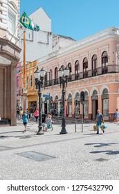 Curitiba - PR, Brazil - December 14, 2018: Downtown cross streets XV de Novembro and Monsenhor Celso. Rua das Flores. Touristic place. Commerce, local people, historic buildings.