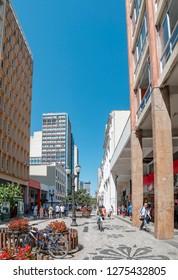 Curitiba - PR, Brazil - December 14, 2018: Downtown street XV de Novembro. Rua das Flores. Touristic place, flowered street, historic downtown. Commerce, local people and tourists.