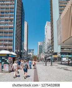 Curitiba - PR, Brazil - December 14, 2018: Downtown cross streets XV de Novembro and Marechal Floriano Peixoto. Rua das Flores. Touristic place. Commerce, local people, historic buildings.