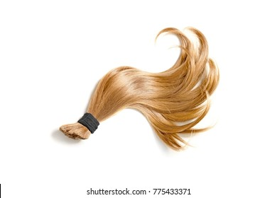 Curl of natural blonde hair on a white background