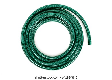 curled garden hose isolated on white