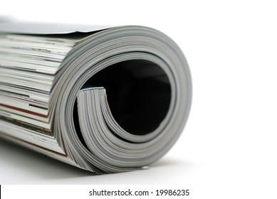 Curled glossy magazine isolated on white background.