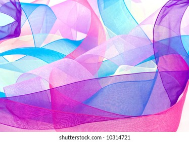 Curled and multicolored organza ribbons mingle in this bright background.