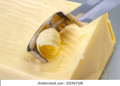 Curling butter into rolls with butter curler kitchen tool