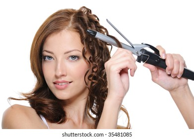 curling female brunette hair with roller - beautiful woman portrait