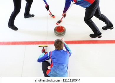 Curling game. The player plays curling on the ice rink
