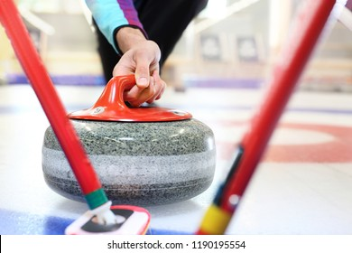 Curling. Players play curling on the curling track.
