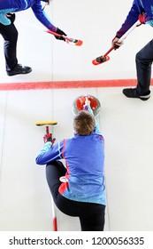 Curling. Precise team game.