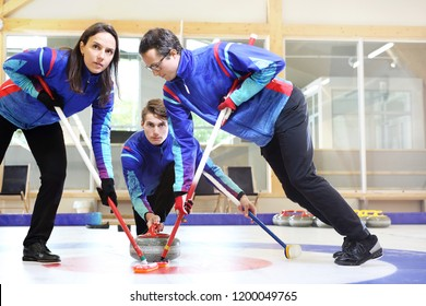 Curling, team playing on the ice.