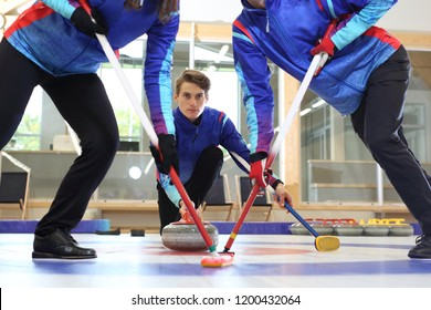 Curling. The curling team plays the tournament.