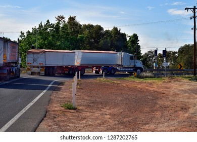 CURLWAA, NSW, AUSTRALIA - NOVEMBER 10: Trucks with trailers usually named Road Trains on traffic light to enter single lane Abbotsford bridge over Murray river, November 10, 2017, Curlwaa, Australia