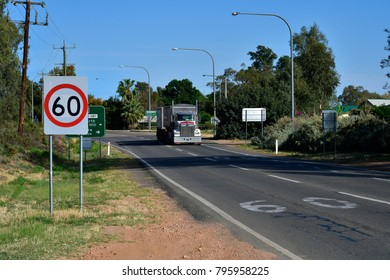 CURLWAA, NSW,AUSTRALIA - NOVEMBER 10: Heavy truck usually  named road train on Silver City Highway in the tiny village in New South Wales on the border to Victoria, on November 10, Curlwaa, Australia