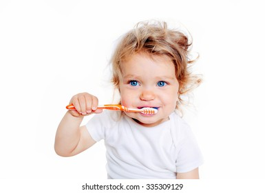 Curly baby toddler brushing teeth. Isolated on white background.