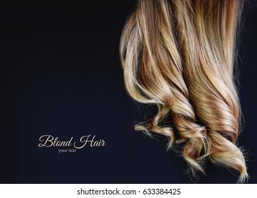 Curly blond hair.
