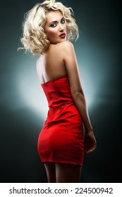 Curly blonde in a red (green background)