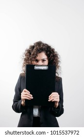 curly girl in business clothes on a white background holding documents