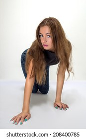 curly girl is on all fours posing looking up