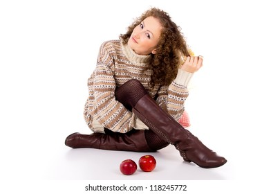 curly girl in winter clothes with apples