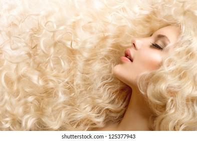Curly Hair. Fashion Girl With Healthy Long Wavy Hair. Beauty Blonde Woman Portrait. Blond Hair, Hair Extension, Permed Hair