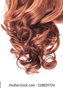 Curly hair fragment placed over the white background as a copyspace backdrop composition