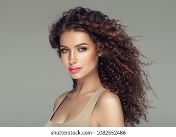 Curly hair woman beautiful beauty portrait, female glamour face with long brunette hairstyle