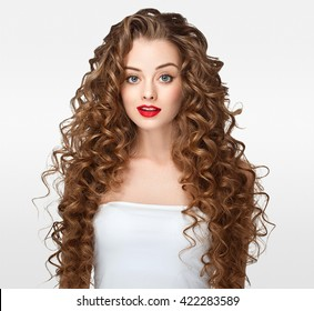 Curly hair woman portrait long hair with perfect make up red lips isolated on white