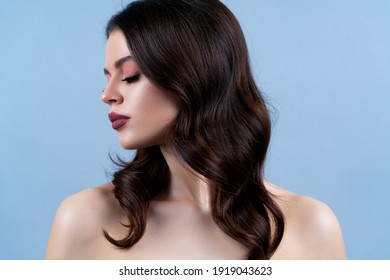 Curly hairstyle. Woman with curly beautiful hair on gray background. Girl with beauty a pleasant smile. Short wavy hairstyle