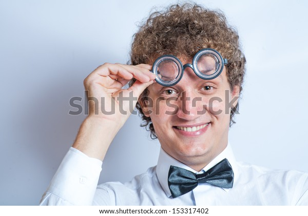 curly man smiling funcy party glasses