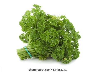 Curly parsley bunch closeup isolated on white