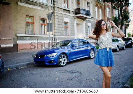Curly Stylish Girl Wear On Blue Stock Photo (Edit Now