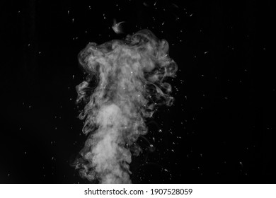 Curly white steam rising up and splashing water scattering in different directions isolated on a black background. Evaporation of liquid and condensation. Can be used as background, design element