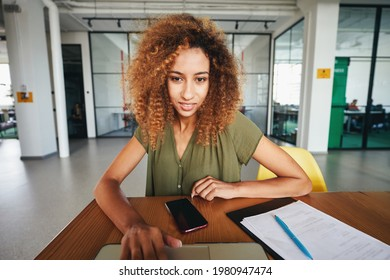 Curly woman setting everything up for a video-call