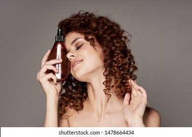 curly young woman beauty hair
