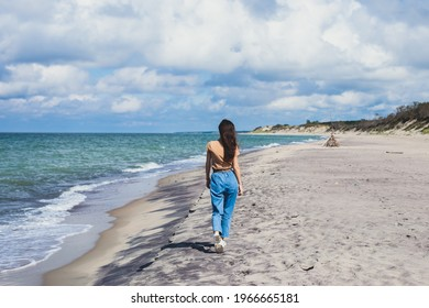 Curonian spit, beautiful vibrant view of Kurshskaya Kosa National Park, Curonian Lagoon and the Baltic Sea, Kaliningrad Oblast, Russia and Klaipeda County, Lithuania, summer day, with a female tourist