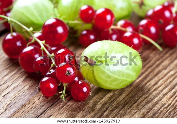 Currants and gooseberries on wood