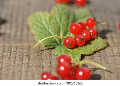 Currants on a wooden background