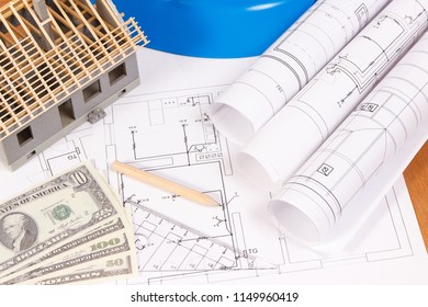 Currencies dollar, electrical diagrams, accessories for engineer jobs and house under construction, concept of building home cost