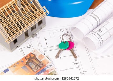 Currencies euro, home keys, electrical drawings or diagrams for engineer jobs and house under construction on desk