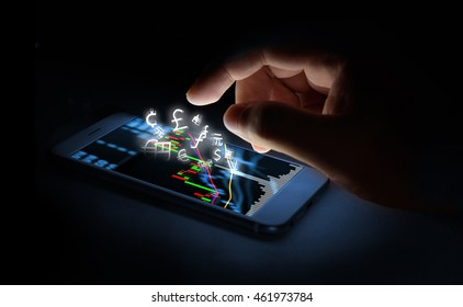 Currencies sign icon and smartphone with stock market graph screen and finger with black background. Blockchain , Fintech Investment Financial Internet Technology Concept.